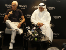 Armani talks about his new business venture to guests and members of the press.