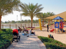 Al Barsha Pond ParkUSP: While there are plenty of places to chill out in this park, its main draw is the 1.4km jogging and cycle tracks and sporting equipment, as well as volleyball, tennis and basketball courts, and a massive pond – although there's no signs of boats yet.Size of park: 52,500 sq m – large enough to play hide and seek for an hour without coming close to finding anyone.Best for: People with active lifestyles, and anyone who is keen to take up a team sport.Shops or kiosks: Nearby Al Barsha Mall has a Union Coop as well as a French Bakery, so you can stop by on your way to grab a few snacks. Also, the local grocery near Roots hair salon is just across 329 road. There's also a sweetcorn vendor inside the park at weekends.Don't miss: The Venice Beach-style muscle equipment and the marked start and finish lines on the bouncy jogging track, as well as sneakers sticking out the bottom of abayas and dishdashas.Nature hunt: The jogging track is lined with date palms and manicured shrubbery bursting with orange and pink flowers.Free. Open Sun-Thu 8am-11pm; Fri-Sat 8am-11.30pm; public holidays 8am-midnight. Enter from behind Emirates NBD Bank and Al Mawakeb School, Barsha.Ball games allowed, Running track, Skating allowed.