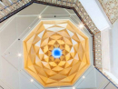 The 10-metre high (33-foot) lobby is capped by an octagonal dome finished with gold leaf, casting a warm glow on the space's creamy marble and enhancing the natural light.