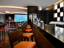 West Beach Bistro & Sports Lounge Top not sports bar with a giant concave screen stretching from floor to ceiling. Taste the value with selected beverages priced between Dhs27-29 from noon until 9pm.  Dress code: casual. Open daily noon-2am. Mövenpick Hotel Jumeirah Beach, Dubai Marina (04 449 8888).
