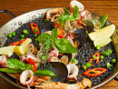 Arroz negro at BOCAThere aren't many uses of squid ink as classy as this one from Mediterranean eatery BOCA. This fancy arroz negro is made with squid ink and it's packed full of veg – locally sourced from The Waterfront Market in Dubai – for a pop of colour. There's also a host of seafood including squid, langoustine, mussels and clams crammed in there. With a hint of chilli and a squeeze of lemon, it's the perfect sharing dish for summer days.Dhs280. Gate Village 6, DIFC (04 323 1833).