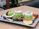 Avo three ways at Walnut GroveFounder Yianni Drakopoulos grew up in a small village outside Kalamata in Greece where they cultivated olive oil and olives. He brings this passion for authentic Mediterranean flavours to Walnut Grove's salads, sandwiches, burgers and desserts. 'Avo three ways' fuses smashed avocado with Greek feta cheese; avocado in sumac on black pepper cream cheese; avocado, rocket and marinated chickpeas with a poached egg and Spanish smoked paprika, all topped with pistachio dukkah and roast cherry tomatoes.Dhs50. Near The Waterfall, Ground Floor (04 362 7500).