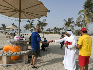 Free umbrellas have been handed out across Dubai