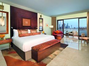 Fairmont-The-Palm---Deluxe-Suite-Bedroom-with-Dubai-Marina-Skyline.jpg